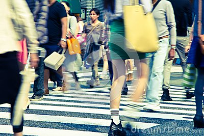 Tourists and business people crossing the street a Editorial Stock Image