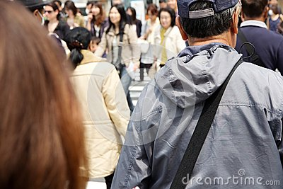 Tourists and business people crossing the street Editorial Stock Photo