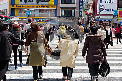Tourists and business people crossing the street Editorial Photography