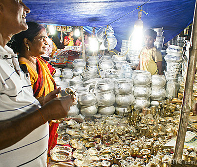 Tourists buying utensils from Puri Street hawkers Editorial Stock Photo