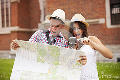 Tourists checking something on map