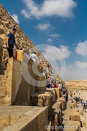 Free Tourists Climbing The Pyramids Of Giza, Egypt Stock Photography - 149435612