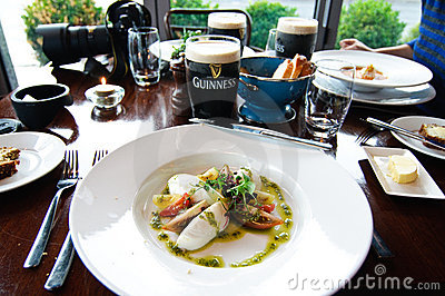 Tourists enjoying a meal in Howth Ireland Editorial Stock Photo
