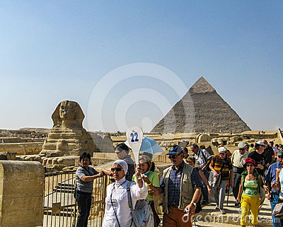 Tourists following a tour guide at Giza. Editorial Image