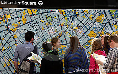 Tourists in front of London map Editorial Photo