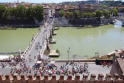 Tourists going on Sant  Angelo Bridge at summer