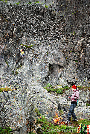 Tourists on a halt under the sheer cliff