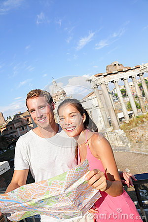 Tourists holding map by Roman Forum, Rome, Italy