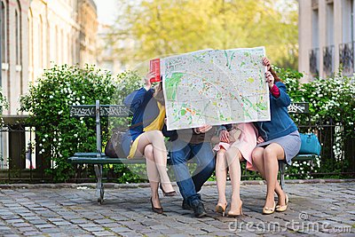 Tourists looking for direction in Paris