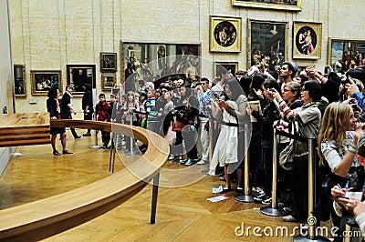 Tourists looking at Mona  Lisa Editorial Image