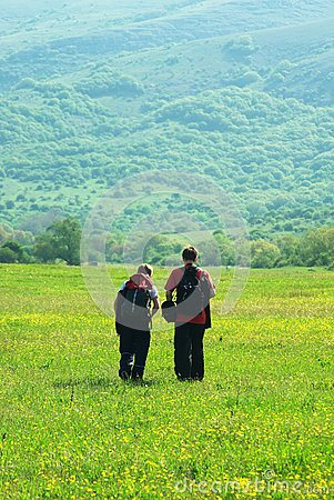 Tourists in mountain meadow