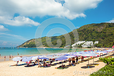 Tourists on the Nai Harn beach Editorial Stock Image
