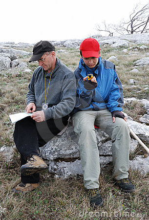 Tourists orienteering by map and GPS.