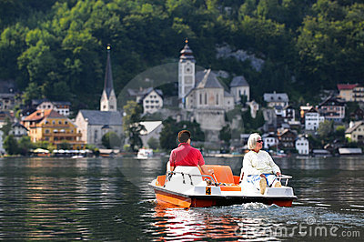 Tourists on pedal boat at Hallstatt, Austria
