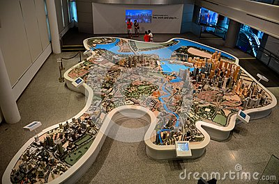 Tourists photograph at scale model of Singapore central district Editorial Image