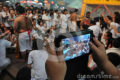 Tourists Photographs a Taoist Ceremony with Tablet Editorial Stock Image