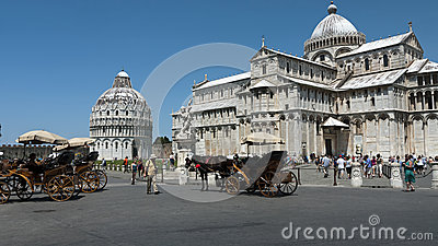 Tourists In Pisa, Italy With Horse Drawn Carriages
