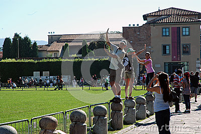 Tourists posing with the Leaning Tower, Pisa, Italy Editorial Stock Photo