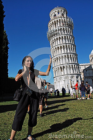 Tourists posing with the Leaning Tower, Pisa, Italy Editorial Stock Image