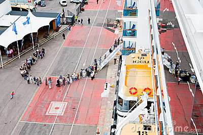 Tourists queue to entry on cruise liner Editorial Image