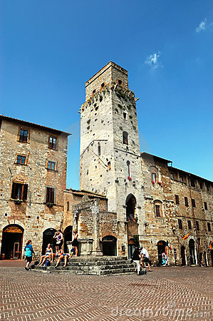 Tourists resting in San Gimignano Square Editorial Photo