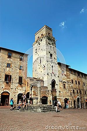 Tourists resting in San Gimignano Square Editorial Photo