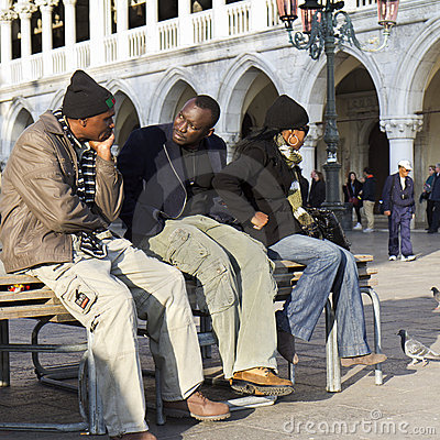 Tourists resting at Venice. Editorial Stock Photo