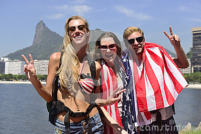 Tourists in Rio de Janeiro with Christ the Redeemer in background.