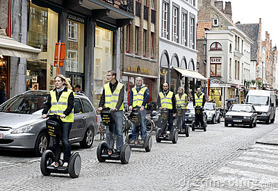 Tourists on Segways in Brugge Editorial Photo
