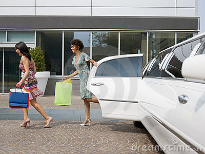 Tourists with shopping bags