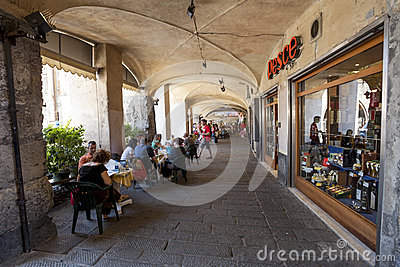 Tourists in sidewalk cafes in Genoa, Italy Editorial Stock Photo