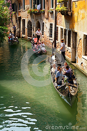 Tourists travel on gondolas in Venice Editorial Photography