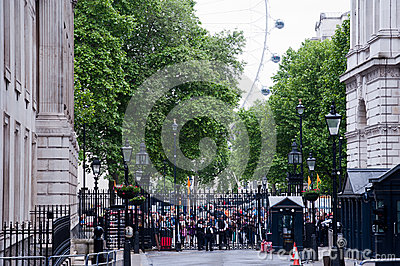 Tourists and visitors outside 10 Downing Street in London Editorial Photo