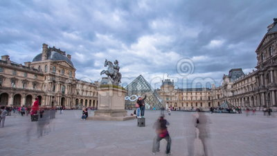 Tourists walk near the Louvre in Paris timelapse. Hyperlapse. The Louvre was once a palace and is now a museum. 4K