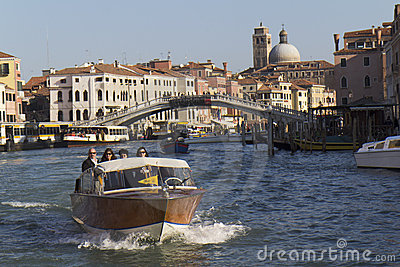 Tourists on a water taxi in Venice Editorial Image