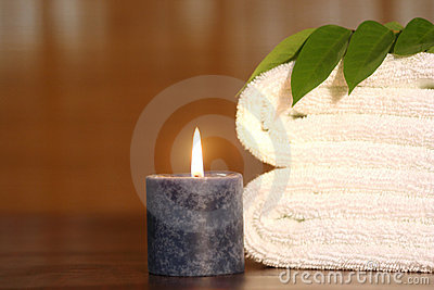 Towel, candle and white towel