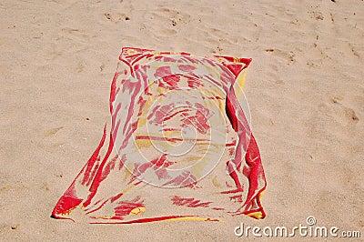 Towel on sand beach