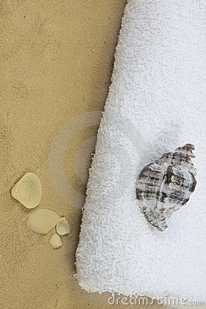 towel, shell and sand