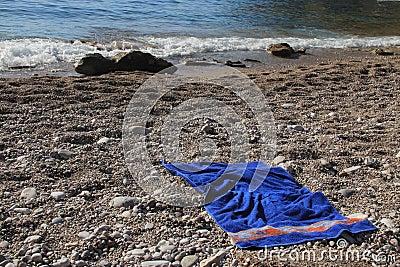 Towel on shingle beach