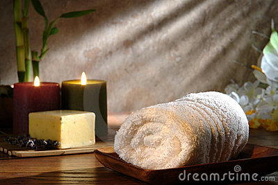 Towel and Soap with Candles in a Relaxation Spa