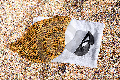 Towel, sunglasses and hat