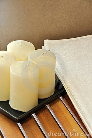 Towel and wax candle for SPA