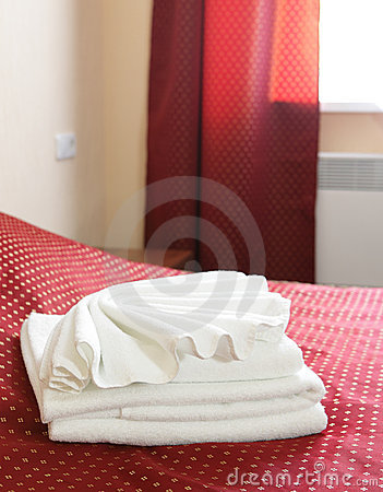 Towels on the bed in hotel