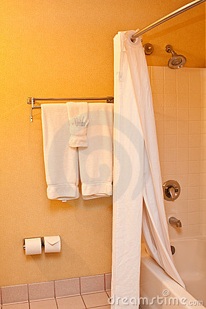 Towels and shower in bathroom