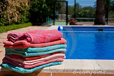Towels beside a swimming pool
