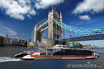 Tower Bridge with boat, London, UK