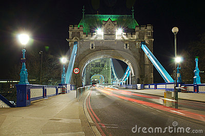 Tower Bridge entrance perspective at night, London