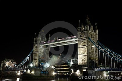Tower Bridge opening at night, London, UK
