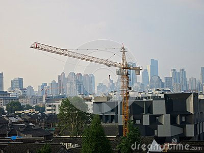 Tower Cranes in front of City Skyline Editorial Photo