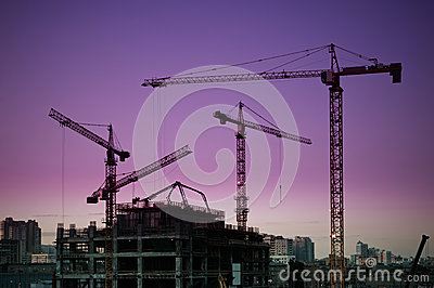 Tower cranes silhouette